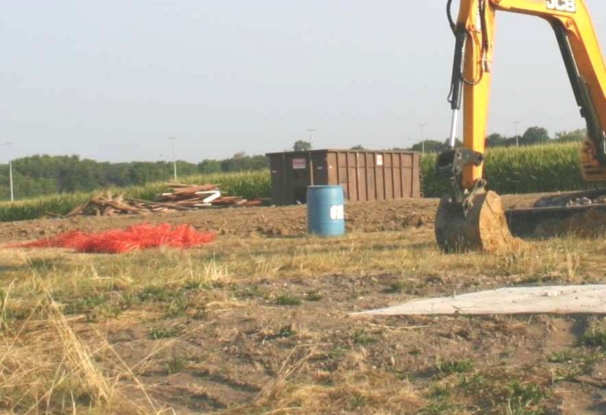 barn buried trash